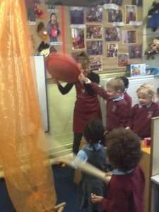 We made a pirate ship in nursery this morning with a sail, a cannon and lots of straw swords.  There was no wind to make the sail billow out so our pirate ship wouldn't move.  We had to make our own wind with a very handy wobble board. Thar' she blows!